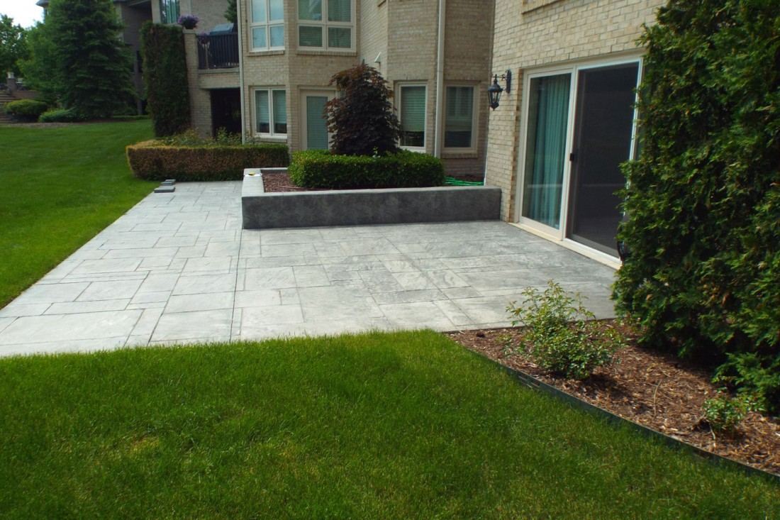 How we transformed a Northville, Michigan plain old patio into a new outdoor kitchen - Blog - Treasured Earth Landscape Design & Build - northville-yard-before